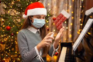 Young woman using hand sanitiser on Christmas Day